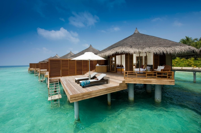 Where was Maldives first overwater villa built?